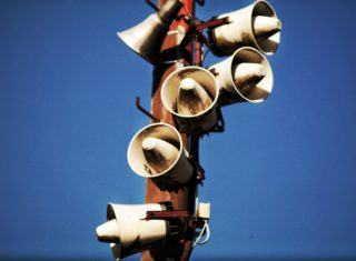 megaphones mounted on a pole